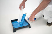 Use the scraper on the Roller Cleaner to remove as much paint as possible from the roller.